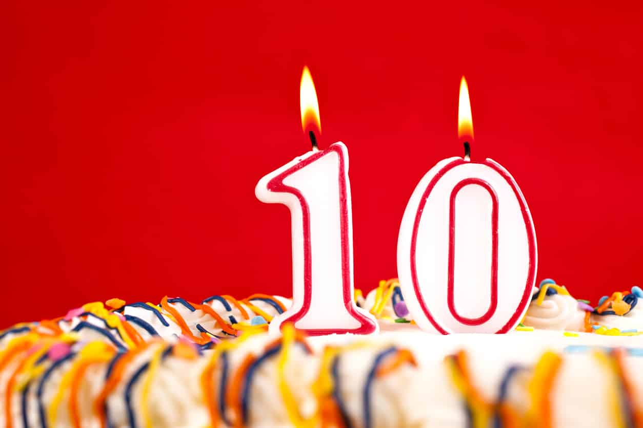Decorated birthday cake with number 10 candles